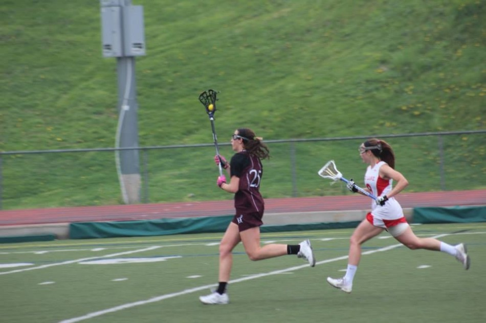 Abby Squirrell beating a defender and going for goal.