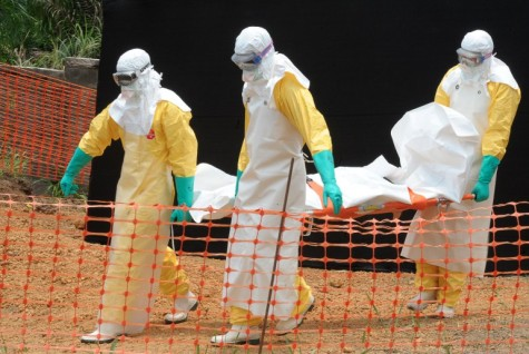 Workers for the charity organization Doctors Without Borders carry a body killed by the Ebola virus early this April.