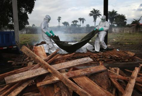 A burial team from the Liberian Ministry of Health unloads the bodies of Ebola
