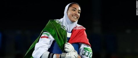 Kimia Alizadeh Zenoorin, of Iran, celebrates after winning a bronze medal in women