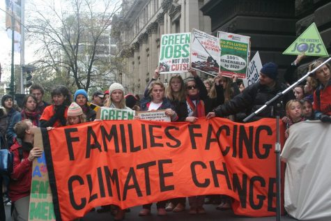 """""""Climate Emergency - Families facing Climate Change"""" by John Englart (Takver) is licensed with CC BY-SA 2.0. To view a copy of this license, visit https://creativecommons.org/licenses/by-sa/2.0/"""